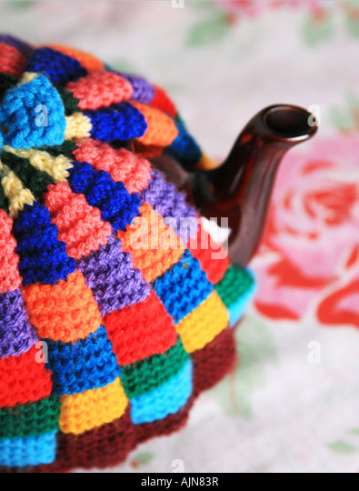 Tea Pot with Cosy - Stock Image