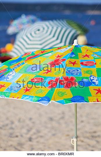 Beach umbrellas, Grand Beach on Lake Winnipeg, Manitoba, Canada. - Stock Image