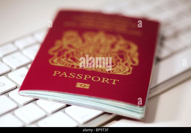 Passport on a computer keyboard - Stock-Bilder
