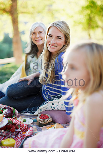 Three generations of women picnicking - Stock Image