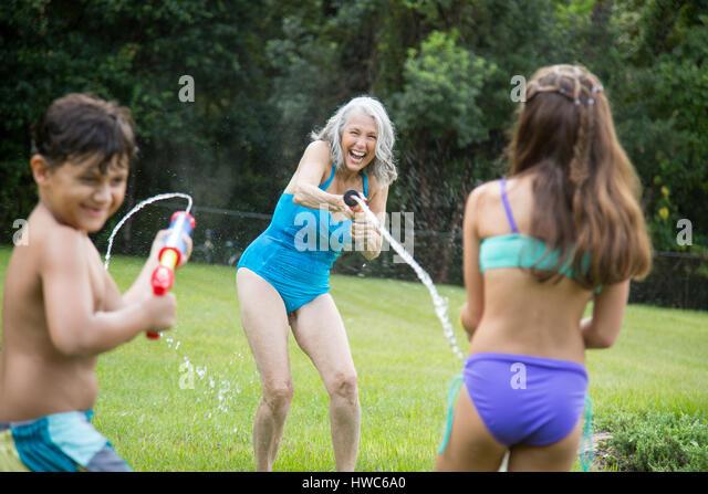 Senior playing with grandchildren - Stock Image