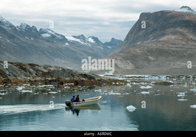 Inuit fisherman leaving the village of Tiniteqilâq, Sermilik Fjord, East Greenland - Stock Image