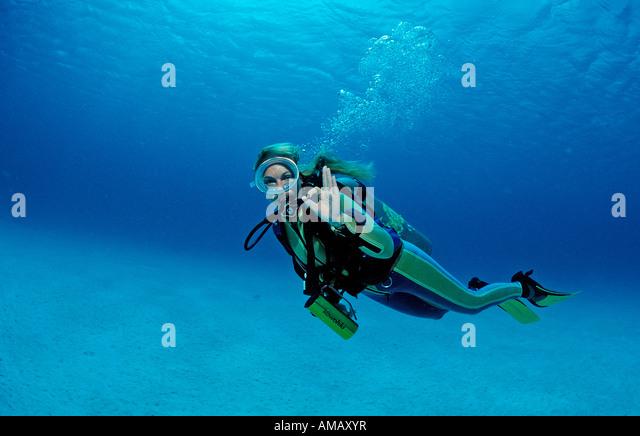Scuba diver shows o K signal Netherlands Antilles Bonaire Caribbean Sea - Stock Image
