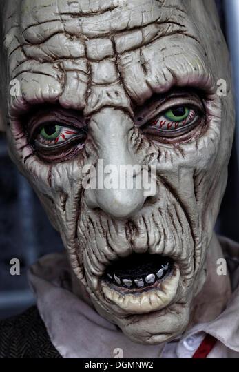 Desperate face, bloodshot eyes, open mouth, haunted house figure - Stock Image
