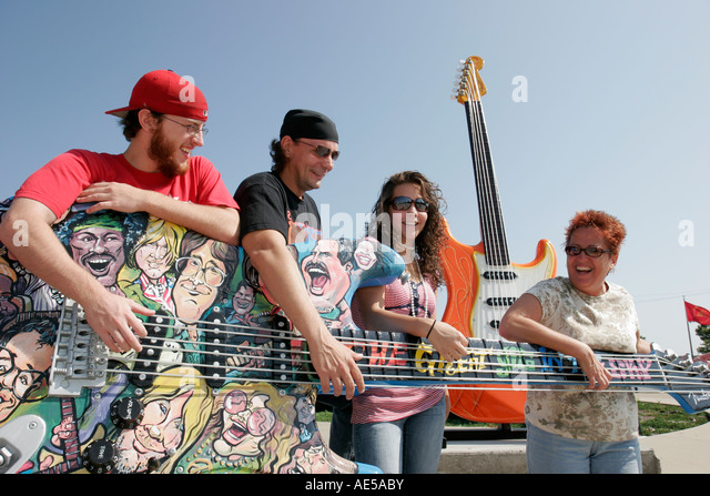 Cleveland Ohio Rock and Roll Hall of Fame family giant guitar art Guitarmania - Stock Image