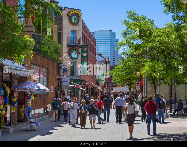 Shops and restaurants on Rue de la Gauchetiere just off Boulevard Saint-Laurent, Chinatown, Montreal, Quebec, Canada - Stock Image