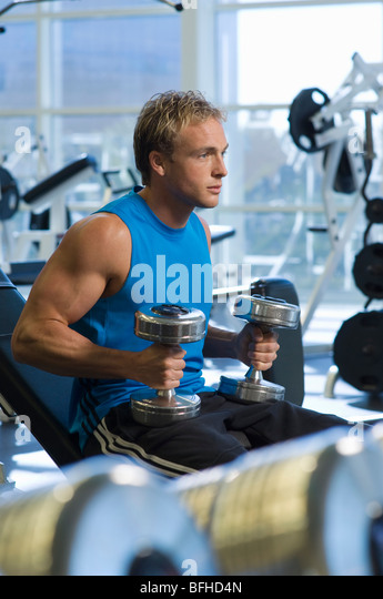 Man Weightlifting With Dumbbells - Stock Image