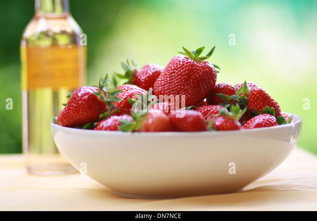 Fresh strawberries in a bowl - Stock Image