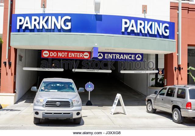 Miami Florida Shops at Midtown parking garage entrance enter exit SUV vehicle sign - Stock Image