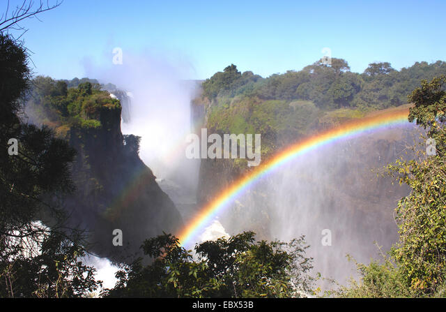 Victoria falls with rainbow, Zimbabwe, Victoria Falls National Park - Stock Image
