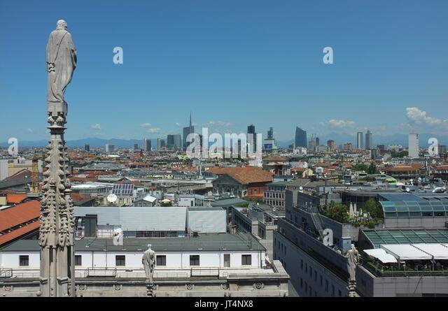 View of the commercial district from the top of The Duomo (Cathedral), Piazza del Duomo, Milan, Lombardy, Italy, - Stock Image