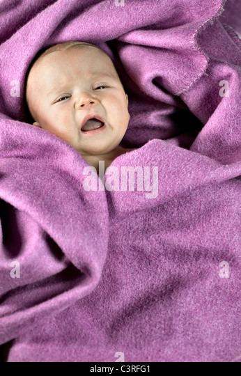 Newborn boy crying - Stock Image