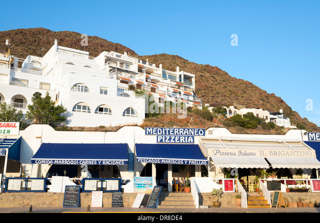 Restaurants along the waterfront in San Jose, Cabo de Gata-Nijar, Andalusia, Spain - Stock Image