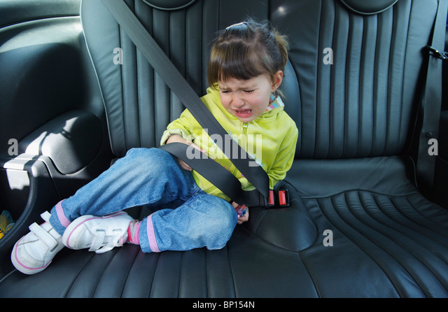 Cadiz, Spain; A Young Girl Cries As She Sits In A Vehicle Wearing A Seat Belt - Stock Image