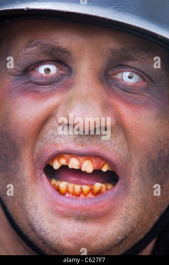 Man dressed as a Zombie at the Film and Comic Convention in London. - Stock Image
