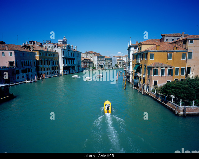 yellow boat on Canal Grande, Venice, UNESCO World Heritage Site, Italy,  Europe. Photo by Willy Matheisl - Stock Image