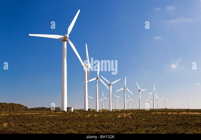 Windturbines farm generating clean power energy - Stock Image