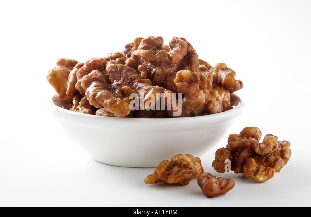 A bowl of candied walnuts with white background cutout - Stock Image