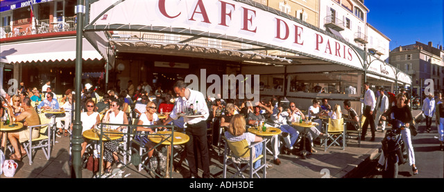 france St Tropez Cafe de Paris terasse people harbour view - Stock Image