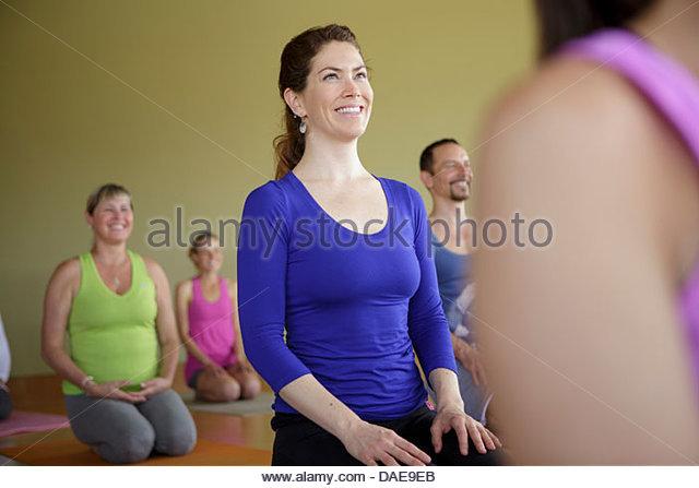 Mixed age group practicing yoga - Stock Image