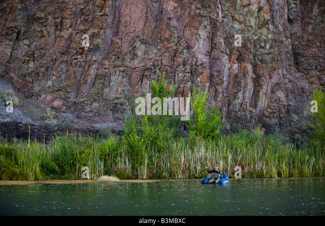 Fly fishing on lower owyhee stock photos fly fishing on for Owyhee river fly fishing