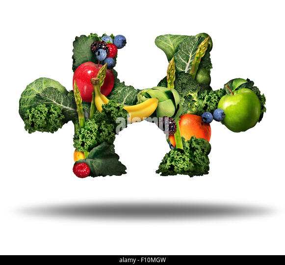 Healthy food solution and eating fresh fruits and vegetables symbol as raw produce shaped as a puzzle piece on a - Stock Image