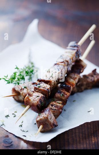 meat skewers with herbs - Stock Image