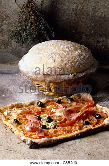 Bacon and black olive pizza - Stock Image