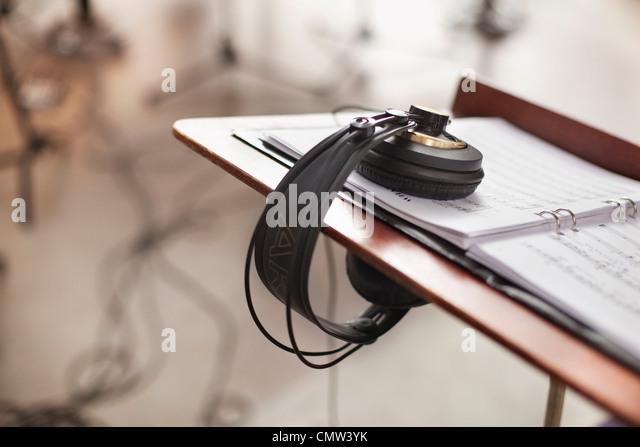 Headphones in music studio - Stock-Bilder