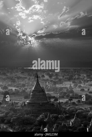 The temples of the Archaeological Zone in Bagan in the late afternoon sunlight.  In the distance is the Irrawaddy - Stock Image