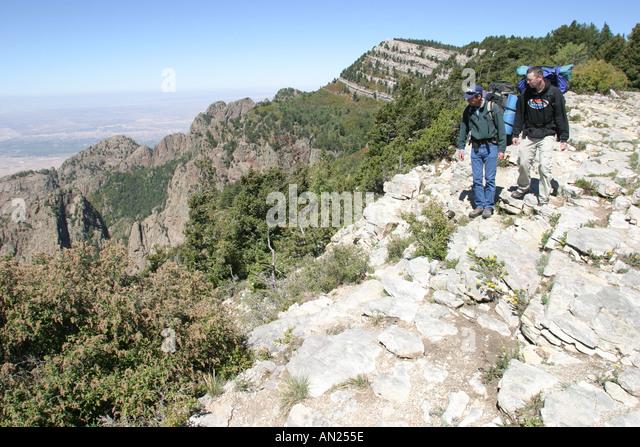Albuquerque New Mexico Sandia Peak ft. hikers near crest W - Stock Image