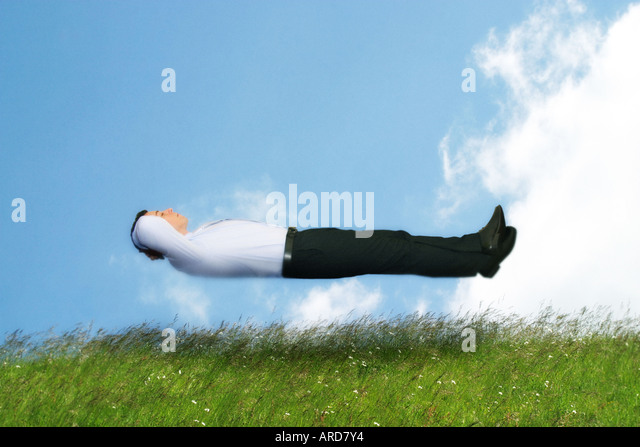 man in shirt and tie floating in the air - Stock-Bilder