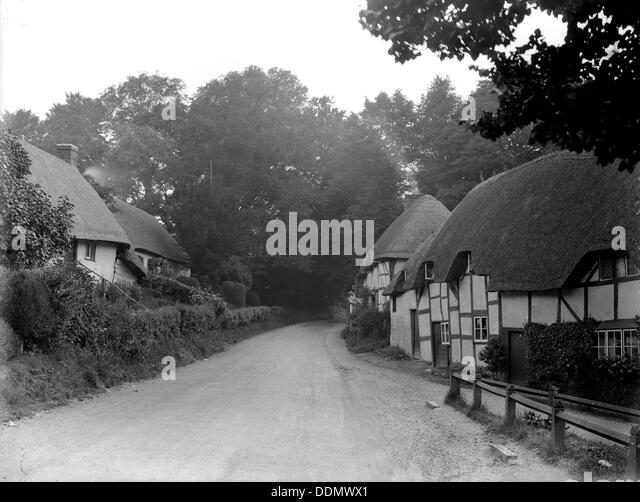 Timber-framed and thatched cottages at Wherwell, Hampshire, 1927. Artist: Nathaniel Lloyd - Stock Image