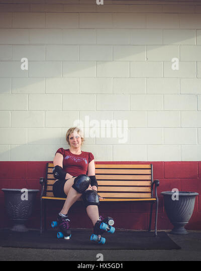 Woman on roller skates outside of a roller rink. - Stock Image