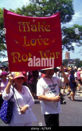 Make love not war protest poster banner Brisbane Queensland Australia Iraq invasion 2003 2405 - Stock Image