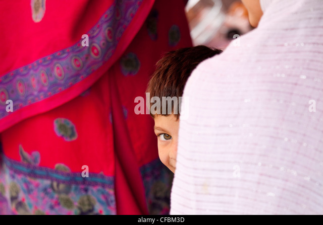 Shy Muslim boy in Islamabad, Pakistan - Stock Image
