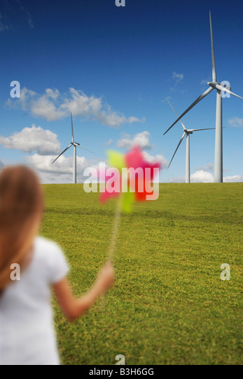 girl with windmill in front of wind turbines - Stock-Bilder