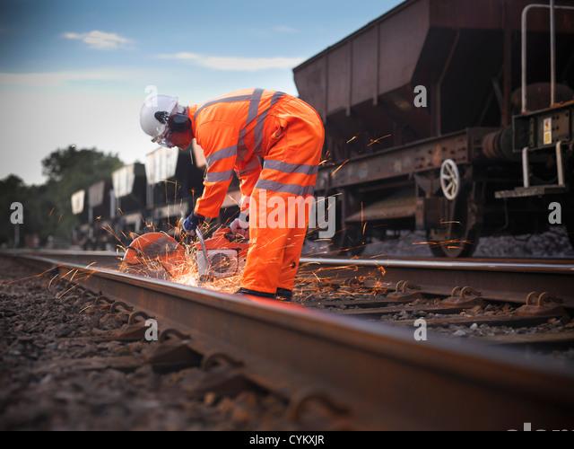 Railway worker adjusting train tracks - Stock Image