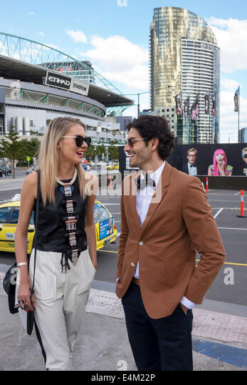 Melbourne Australia Victoria Docklands Harbour Esplanade Melbourne Fashion Festival fashionable man woman couple - Stock Image