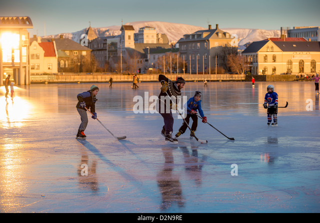 Playing ice hockey on the pond in Reykjavik, Iceland. Tjornin is the Icelandic name for The Pond. - Stock Image