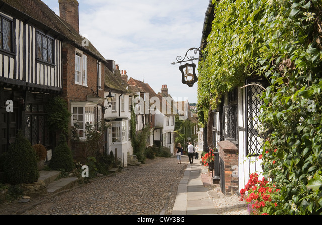 Rye East Sussex England UK Visitors admiring period buildings in medieval cobbled Mermaid Street dating to 16thc - Stock Image