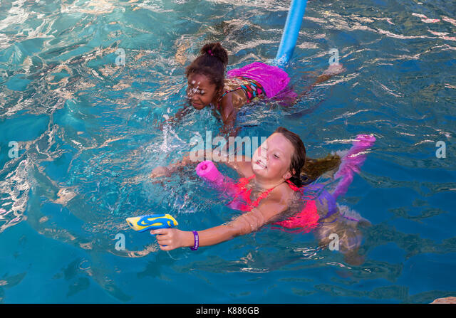 2 teens african american stock photos 2 teens african american stock images alamy for What is a freshwater swimming pool