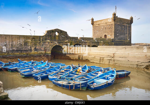 Blue fishing boats in the harbour of Essaouira, Morocco Morocco, Africa - Stock Image