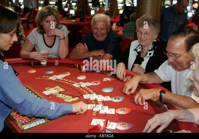 Puerto Rico Atlantic Ocean Holland America Line ms Noordam Casino blackjack table dealer gambling cards - Stock Image