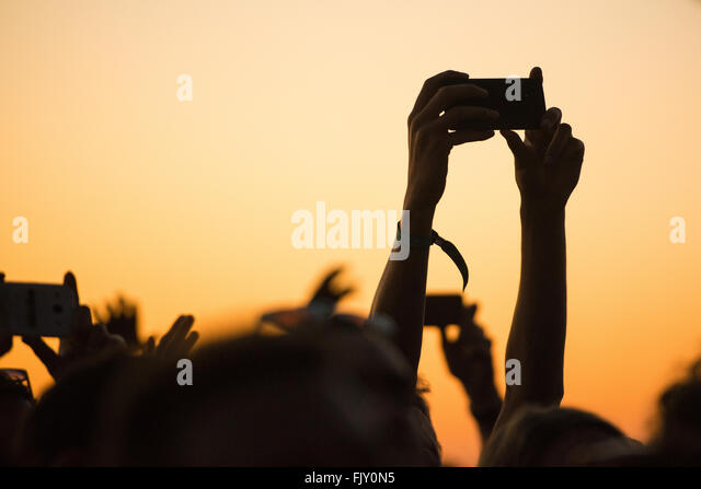 Cropped Hands Photographing Through Smart Phones During Music Festival - Stock-Bilder