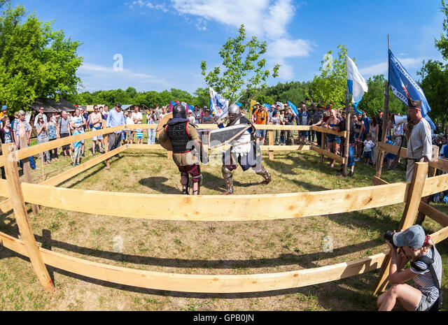 Historical restoration of knightly fights on free festival of medieval culture - Stock Image
