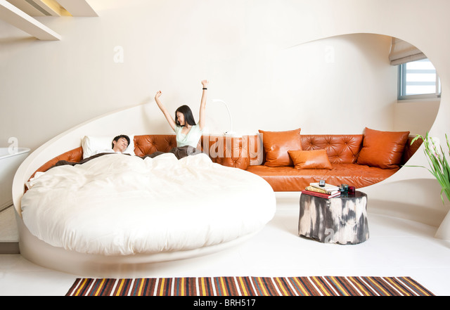 Young couple in luxurious bedroom - Stock Image