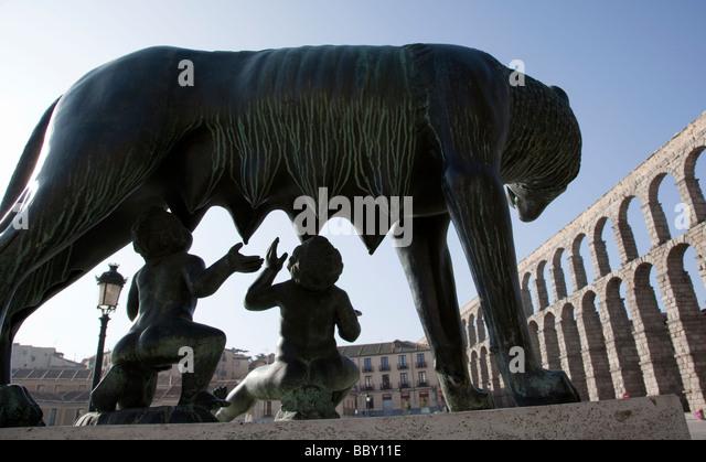 Capitoline Wolf statue and Roman Aqueduct Segovia Spain - Stock Image