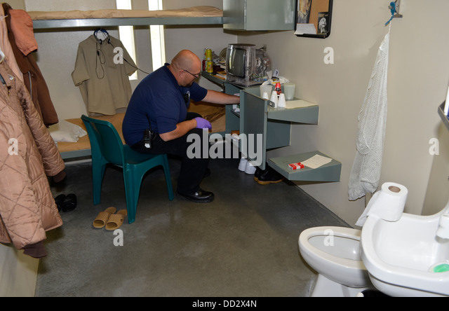 Unit staff conducting a cell search in a maximum security prison in Lincoln, Nebraska. Maintaining high security. - Stock Image