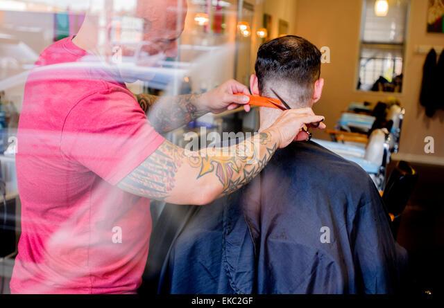 Young man having his hair cut - Stock-Bilder